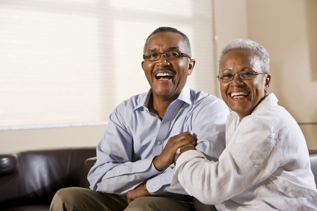 Portrait of a happy, mature African American couple sitting together