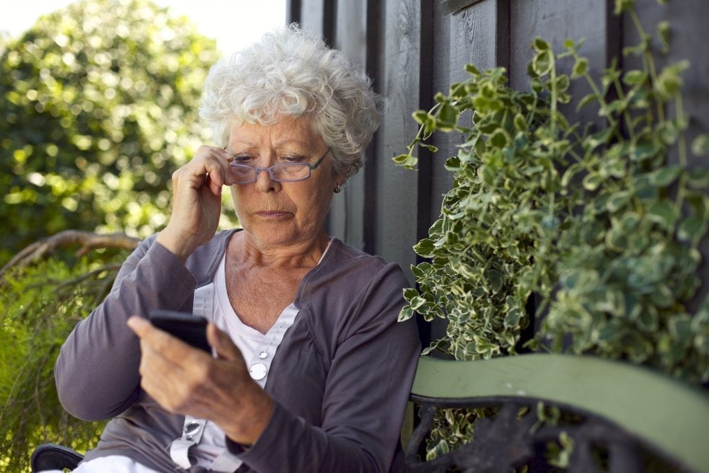 woman reading on her smart phone